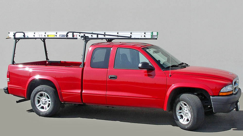Rail Rack II with Extension Carrying a 24-foot Extension Ladder