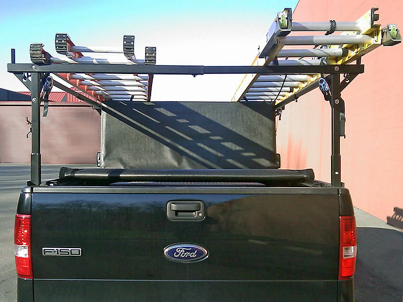 The Extra-Wide Stake Pocket Rack with two ladders and a Folding Tonneau Cover